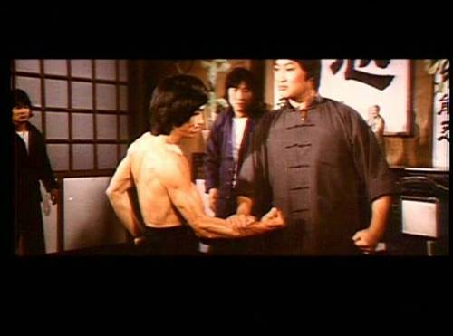 Tony Leung Siu Hung about to be hit by the great Samo Hung in Enter the Fat